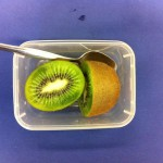 Kiwi fruit with spoon.